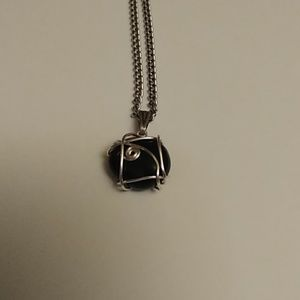 Jewelry - Hand wrapped black stone pendant in silverwire